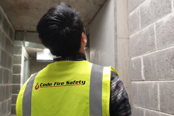 code fire safety engineer inspecting building